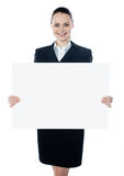 Businesswoman holding a blank white poster Royalty Free Stock Photo