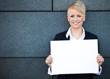 Businesswoman holding blank white sign Stock Photography