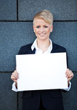 Businesswoman holding blank white sign Stock Photos