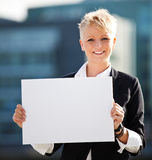 Businesswoman holding blank white sign Royalty Free Stock Images