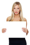 Businesswoman is holding blank whiteboar Royalty Free Stock Photos