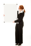 Businesswoman holding blank whiteboard Royalty Free Stock Images