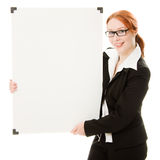 Businesswoman holding blank whiteboard sign. Royalty Free Stock Image