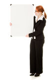 Businesswoman holding blank whiteboard sign. Stock Photos