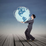 Businesswoman holding blue earth planet Stock Photos