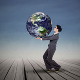 Businesswoman holding blue global world Royalty Free Stock Image