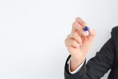 Businesswoman holding a blue pen, isolated on a white background template Royalty Free Stock Photography