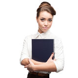 Businesswoman holding book Stock Image