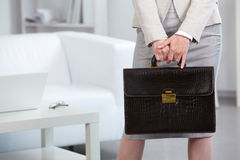 Businesswoman holding briefcase Royalty Free Stock Photos