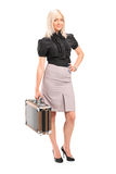 Businesswoman holding a briefcase Royalty Free Stock Photos