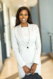 Businesswoman holding briefcase. Attractive african businesswoman holding briefcase royalty free stock image