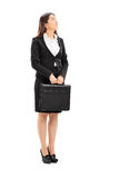 Businesswoman holding a briefcase Royalty Free Stock Image