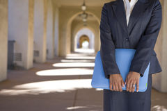 Businesswoman holding briefcase outdoors Royalty Free Stock Photos