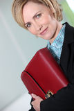 Businesswoman holding briefcase. Royalty Free Stock Photos