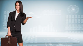 Businesswoman holding briefcase and showing empty Royalty Free Stock Images