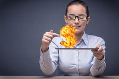 The businesswoman holding burning american dollar sign Stock Photos