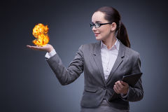 The businesswoman holding burning american dollar sign. Businesswoman holding burning american dollar sign Royalty Free Stock Images