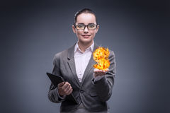 The businesswoman holding burning american dollar sign. Businesswoman holding burning american dollar sign Stock Photography