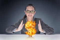 The businesswoman holding burning american dollar sign. Businesswoman holding burning american dollar sign Stock Photo