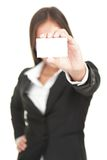 Businesswoman holding business card. Businesswoman in suit holding business card. Beautiful (really!) mixed chinese asian / caucasian business woman. Isolated on Royalty Free Stock Photo