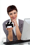 Businesswoman holding a business card holder Stock Photo