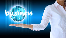 Businesswoman holding business  world Stock Images