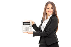 Businesswoman holding a calculator Royalty Free Stock Image