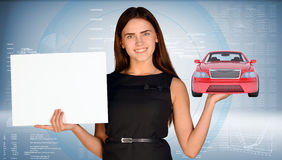 Businesswoman holding car Stock Image