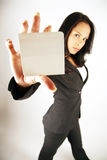 Businesswoman holding card Royalty Free Stock Photos