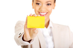 Businesswoman holding a card. Royalty Free Stock Photography