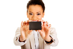 Businesswoman holding a card. royalty free stock photos