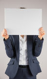 Businesswoman holding card over face Royalty Free Stock Photos