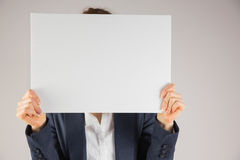 Businesswoman holding card over face Royalty Free Stock Images