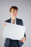 Businesswoman holding card over face Stock Photo