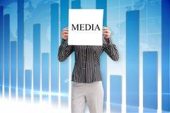 Businesswoman holding card saying media Royalty Free Stock Photo