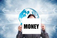 Businesswoman holding card saying money Stock Photos