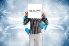 Businesswoman holding card saying perspective Stock Photo