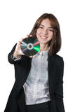 Businesswoman holding the cd disk in her hand. Portrait of young smilling businesswoman holding the cd disk in her hand isolated on white Stock Photography