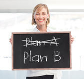 Businesswoman holding a chalkboard Royalty Free Stock Photos
