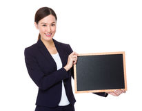 Businesswoman holding with chalkboard Stock Image