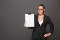 Businesswoman holding a clip board Royalty Free Stock Photos