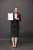 Businesswoman holding a clip board Royalty Free Stock Image