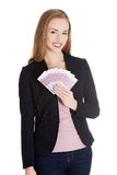 Businesswoman holding a clip of dollars Stock Photography