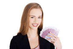 Businesswoman holding a clip of dollars Stock Image