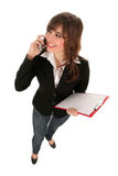 Businesswoman holding clipboard Stock Images