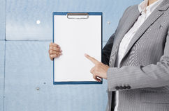 Businesswoman holding a clipboard Stock Image
