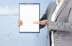 Businesswoman holding a clipboard Stock Photography