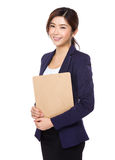 Businesswoman holding the clipboard file Stock Photos