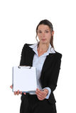 Businesswoman holding clipboard Stock Photos