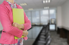 Businesswoman holding clipboard in meeting room Royalty Free Stock Images